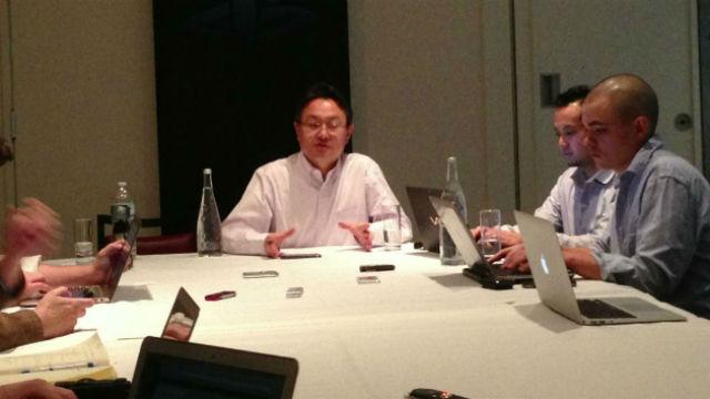 Shuhei Yoshida speaking to reporters yesterday.
