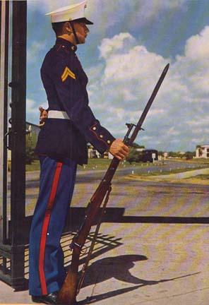 Marine in Dress Blues uniform.