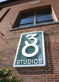 The company logo outside their studio in Maynard.