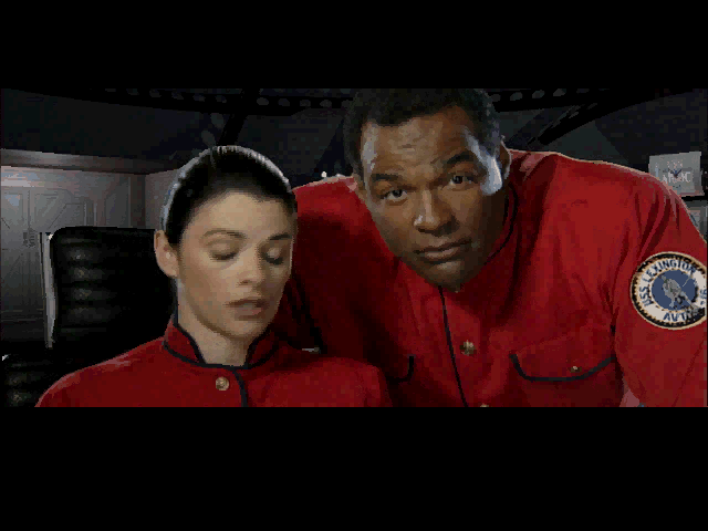 How about Michael Dorn? The actor best known for the ornery and often injured Klingon Starfleet officer Worf here plays Captain Dayna, who spends most of his time looking concerned at a computer console and giving orders. So, playing to his strengths.