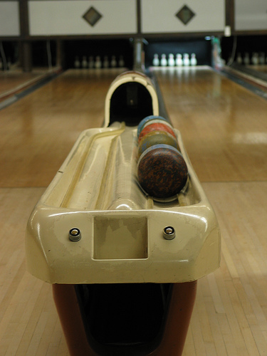 Duckpin balls and pins in back