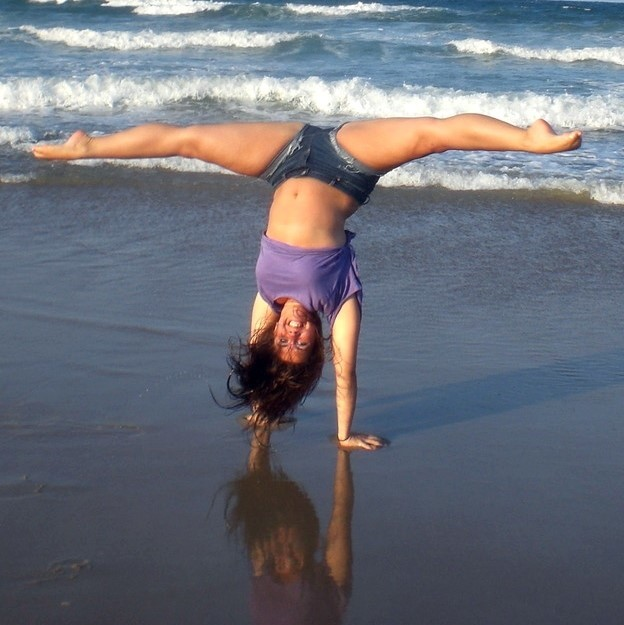 A more skilled cartwheel, with legs spread wide in a straddle, or