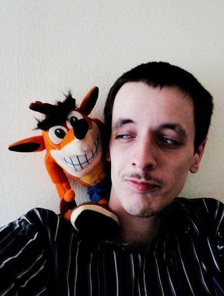 Lenox poses with his little orange buddy.