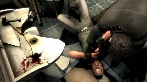 Sam interrogates his target in the bathroom.