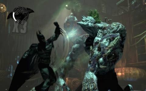 The Titan Joker fighting Batman near the end of the game.