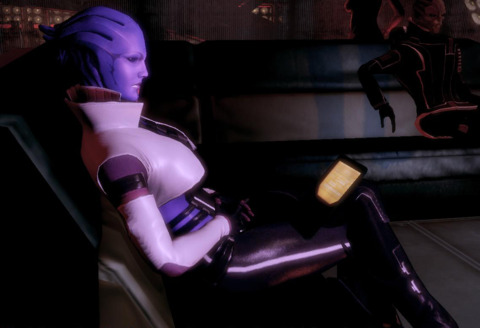 Aria conversing with Shepard on her couch