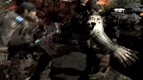 Marcus chainsawfying a Locust aboard a Derrick in Gears Of War 2