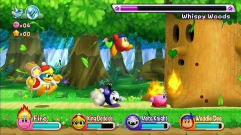 Team Kirby In action vs. classic boss Whispy Woods
