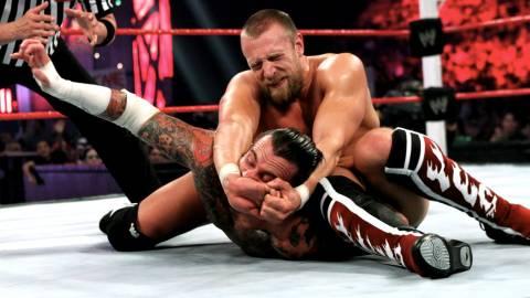 Daniel Bryan applying the Lebell Lock to CM Punk