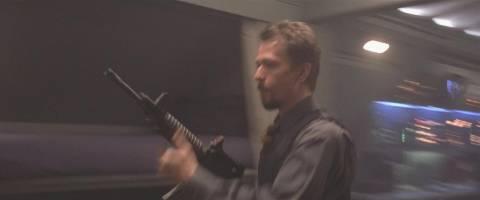 Korshunov, portrayed by Gary Oldman, readies his M4 Carbine.