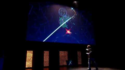 Mizuguchi demonstrating Child of Eden with Kinect at E3 2010.