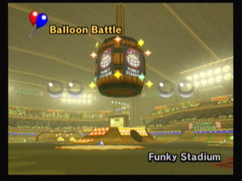 The biggest arena of Mario Kart Wii, Funky Stadium. The crowd cheers when it's time for battle!