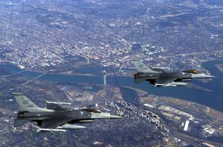 Aerial view of two F-16 fighter Jets flying over downtown DC