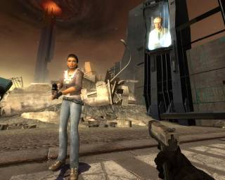 Alyx with an information screen featuring Isaac Kleiner behind her