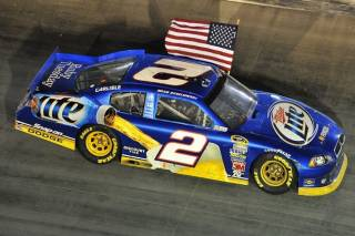 After each victory he drives around with the American flag