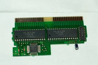 The PCB of the Scandinavian release, showing the custom mapper chip (the square-shaped chip).