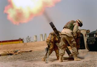 American soldiers firing a Israeli-made M120 Mortar