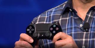 Mark Cerny reveals the DualShock 4 during the PlayStation Meeting 2013.
