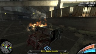 Damage and blood on a car, with a destroyed AI vehicle behind.