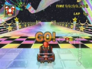 Mario is about to start his time trial run at Rainbow Road.