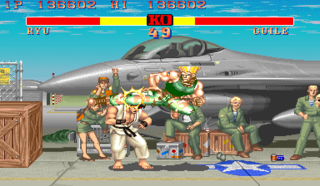 Ryu (left) getting kicked in the head by Guile (right).