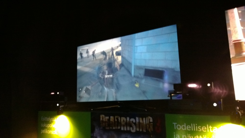 You can see the red Kinect lights on both sides of the screen in this very blurry photo.