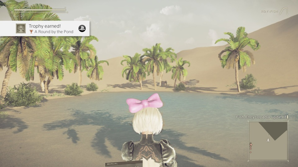 A screenshot of Nier Automata. I still like the pink ribbon. The game has precious few cosmetic items if you didn't get the preorder stuff.