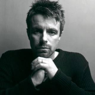 Black and white photo of Harry Gregson-Williams.
